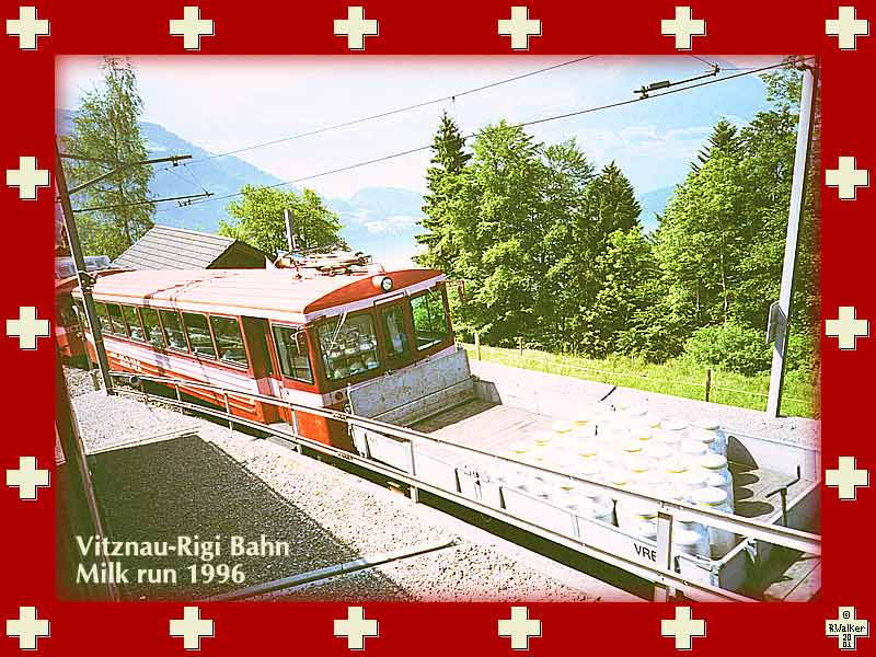 The Vitznau-Rigi Bahn milk run, 1996. Note the reflection of the milk cans in the windshield - looks like they are inside. These red trains ascend the Rigi mountain from a different side than the Arth-Goldau (blue) trains (not shown), but apparently are now operated by the same company.